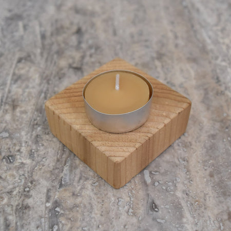 yellow beeswax tealight candle in an aluminum cup