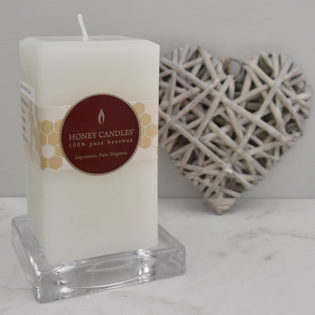 white beeswax five inch square pillar candle on kitchen counter