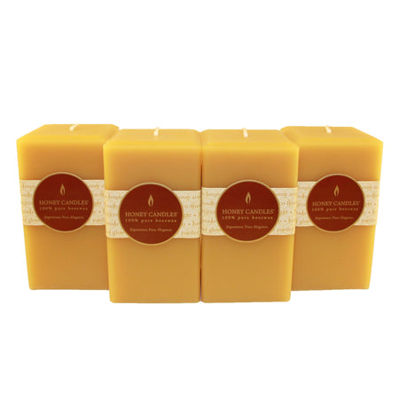 a group of 5 inch tall square beeswax candles in natural color