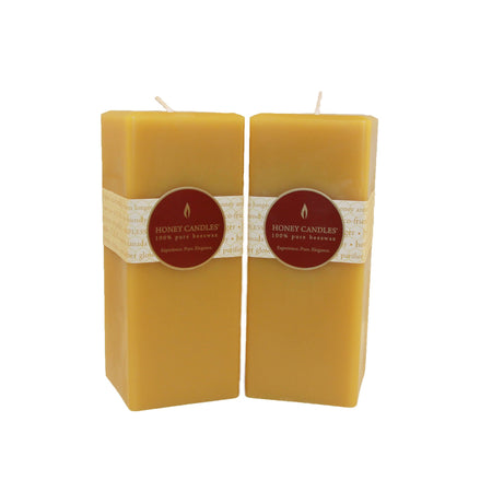 a pair of two 7 inch tall square beeswax pillar candles