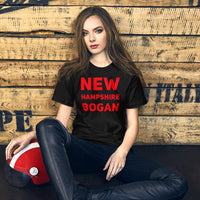 "seated white female bodied model with long hair wearing black tshirt with red letters ""new hampshire bogan"" copyright americanbogan.com"