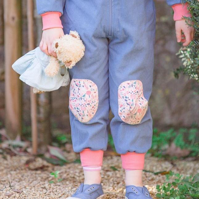 Organic cotton kids boilersuit. Little Adventure Suit Co. Ditsy Dog Little Adventure Suit. Patterned knee patches, gorgeous pink dog and flowers embroidery. Pink boilersuit for little girls.