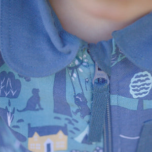 Organic cotton kids boilersuit. Little Adventure Suit Co. All-over Adventure print.