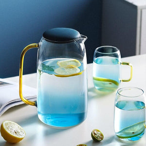 Blue glass pitcher and cups with gold handles