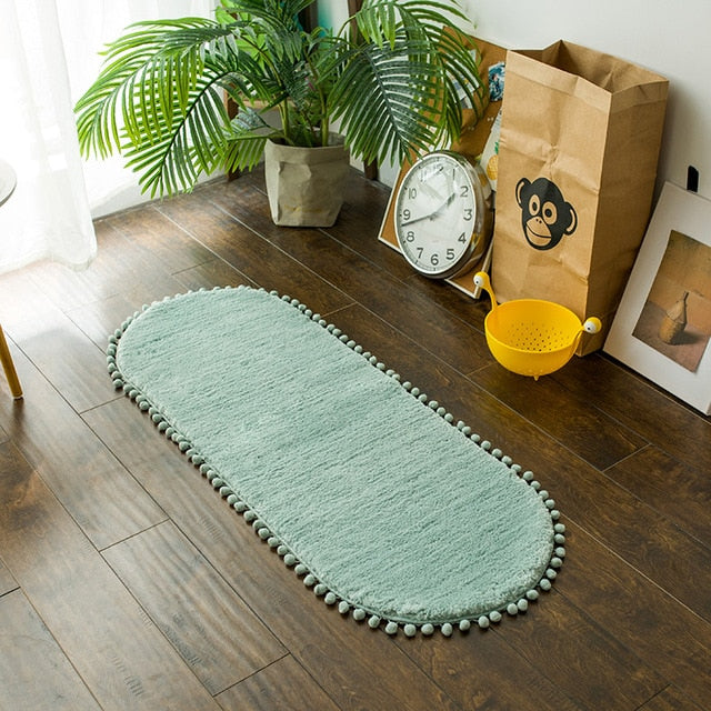 Pom-pom Trimmed Oval Anti-skid Rug