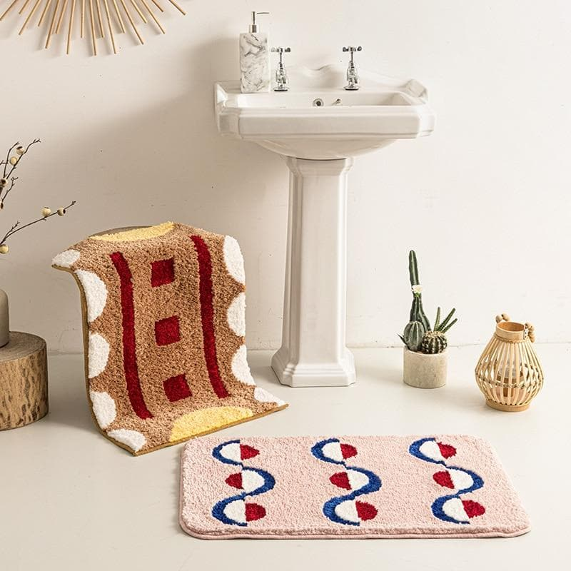 bath mat geometric soft blush and brown red ivory yellow blue