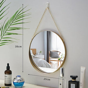 Round Gold Mirror with gold chain link hung on wall