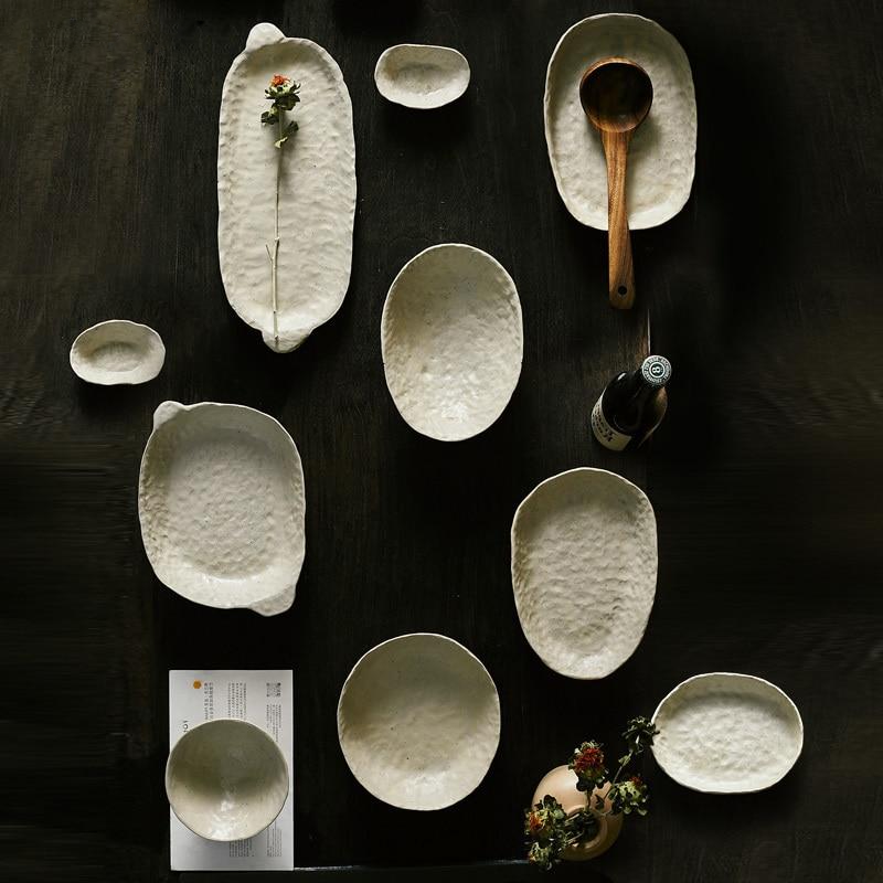 abstract round stone textured white ceramic bowls and plates
