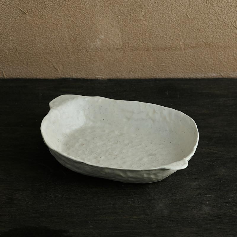 abstract round stone textured white ceramic plate