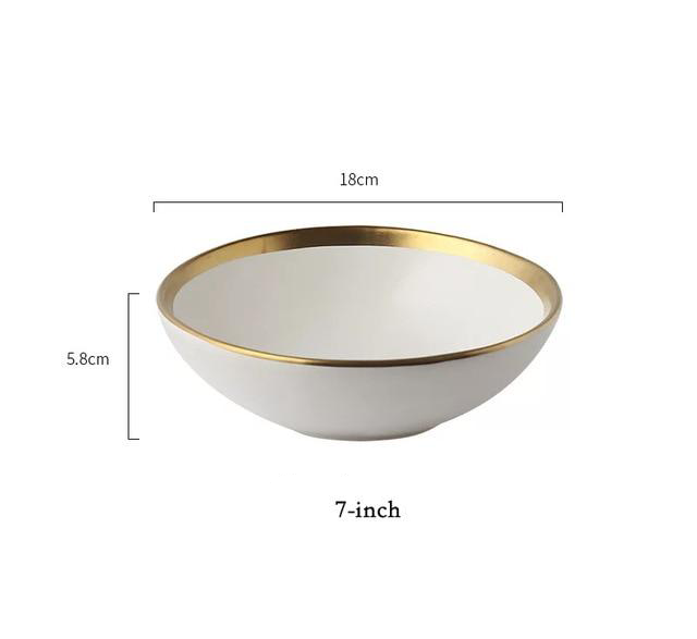 white bowl with gold rim