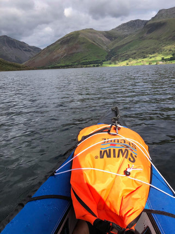 Wild Swim Bag in use while SUP