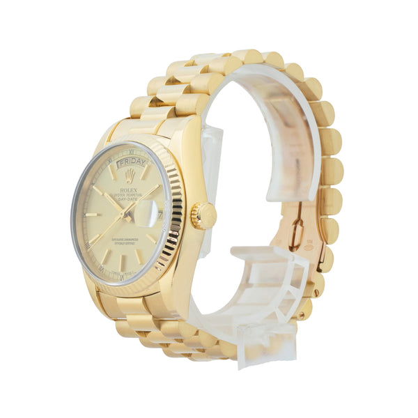 ROLEX DAY-DATE 36 18038 . Brand Rolex Model Day-Date 36 Model Number 18038 Gender Men/Unisex Movement Automatic 3055 Case Size 36mm Wrist Size 7 inches Case Material 18kt Yellow Gold  Bezel 18kt Yellow Gold  fluted Crystal Sapphire Bracelet 18kt Yellow Gold president bracelet Dial  Champagne Condition Excellent Age 1985 - 89xx Box Comes with SLW presentation box Paper No Warranty Comes with one year SLW warranty Notes ENTER Notes