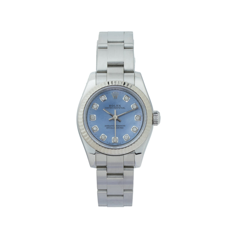 ROLEX OYSTER PERPETUAL 26 176234 . Brand Rolex Model Oyster Perpetual Model Number 176234 Gender Ladies Movement 2231 Case Size 26mm Wrist Size 6 inches Case Material Stainless steel Bezel 18kt white gold fluted bezel Crystal Sapphire  Bracelet Stainless Steel oyster bracelet  Dial Dolor Custom Blue Mother of pearl w/ diamond markers Condition Very Good Approximate Age 2007 - M serial Box Comes with SLW presentation box Paper No Warranty Comes with one year SLW warranty Notes ENTER Notes
