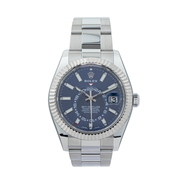 ROLEX SKY-DWELLER 326934 . Brand Rolex Model Sky-Dweller Model Number 326934 Gender Mens/Unisex Movement Automatic 9001 Case Size 42mm  Wrist Size 8 inches Case Material Stainless steel Bezel 18kt White Gold fluted bezel Crystal Sapphire Bracelet Stainless Steel oyster Dial  Blue Condition Unworn Approximate Age 2016 or newer Box Yes Paper Yes  Warranty Comes with one year SLW warranty Notes ENTER Notes