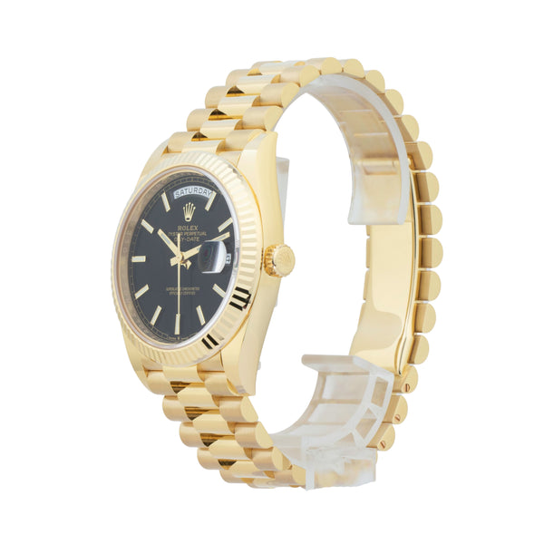 ROLEX DAY-DATE 40 228238 . Brand Rolex Model Day-Date 40 Model Number 228238 Gender Mens/Unisex Movement Automatic 3255 Case Size 40mm Wrist Size 8 inches Case Material 18kt yellow gold Bezel 18kt yellow gold fluted bezel Crystal Sapphire Bracelet 18kt yellow gold presidential bracelet Dial  Black Condition Unworn Age 2020 Box Yes Paper Yes Warranty Comes with one year SLW warranty Notes ENTER Notes
