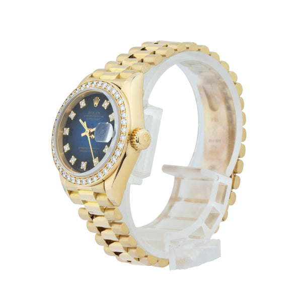 ROLEX LADY-DATEJUST PRESIDENT 26mm 69178 . Brand Rolex Model Lady Datejust Model Number 69178 Gender Ladies Movement Automatic 2135 Case Size 26mm Wrist Size 6 inches Case Material 18kt yellow gold Bezel Diamond bezel Crystal Sapphire  Bracelet 18kt yellow gold president Dial  Blue Vignette diamond dial Condition Good Approximate Age 1989 - L serial Box Comes with SLW presentation box Paper No Warranty Comes with one year SLW warranty Notes ENTER Notes