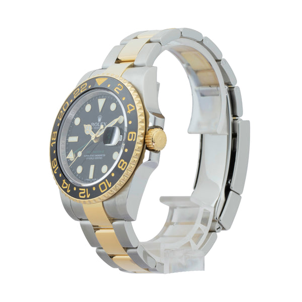 GMT-MASTER II 116713 TWO-TONE . Brand Rolex  Model GMT-Master II Model Number 116713 Gender Mens/Unisex Movement Automatic 3186 Case Size 40mm Wrist Size 7.5 Inches Case Material Stainless Steel Bezel 18kt Yellow Gold w/ Ceramic insert Crystal Sapphire Bracelet Stainless Steel and 18kt Yellow Gold oyster Dial Color Black Condition Very Good Approximate Age 2010 or newer Box comes with SLW Presentation Box Paper Yes Warranty One Year SLW Warranty Card Notes ENTER Notes