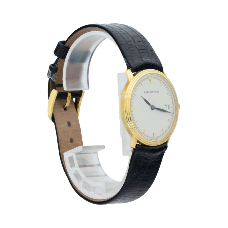 AP CLASSIC 18KT YELLOW GOLD 31MM . Brand AP Model Classic Model Number Gender Unisex Movement Quartz Case Size 31mm Wrist Size 7.5 inches Case Material 18kt Yellow Gold Bezel 18kt Yellow Gold Crystal Sapphire Bracelet Black leather  Dial Color Ivory Condition Very Good Approximate Age 1980s Box No Paper No Warranty Comes with one year SLW warranty Notes ENTER Notes