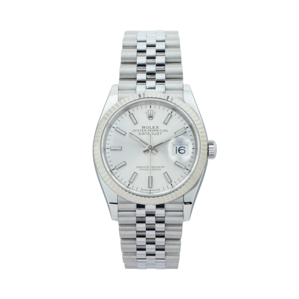ROLEX DATEJUST 36 126234 . Brand Rolex Model Datejust  Model Number 126234 Gender Mens/Unisex Movement Automatic 3235 Case Size 36mm Wrist Size 7 inches Case Material Stainless Steel Bezel 18kt White Gold fluted Crystal Sapphire  Bracelet Stainless Steel jubilee Dial  Silver Condition Excellent Approximate Age 2019 Box SLW Presentation box Paper Yes - card dated 08/2019 Warranty One year SLW warranty Notes ENTER Notes