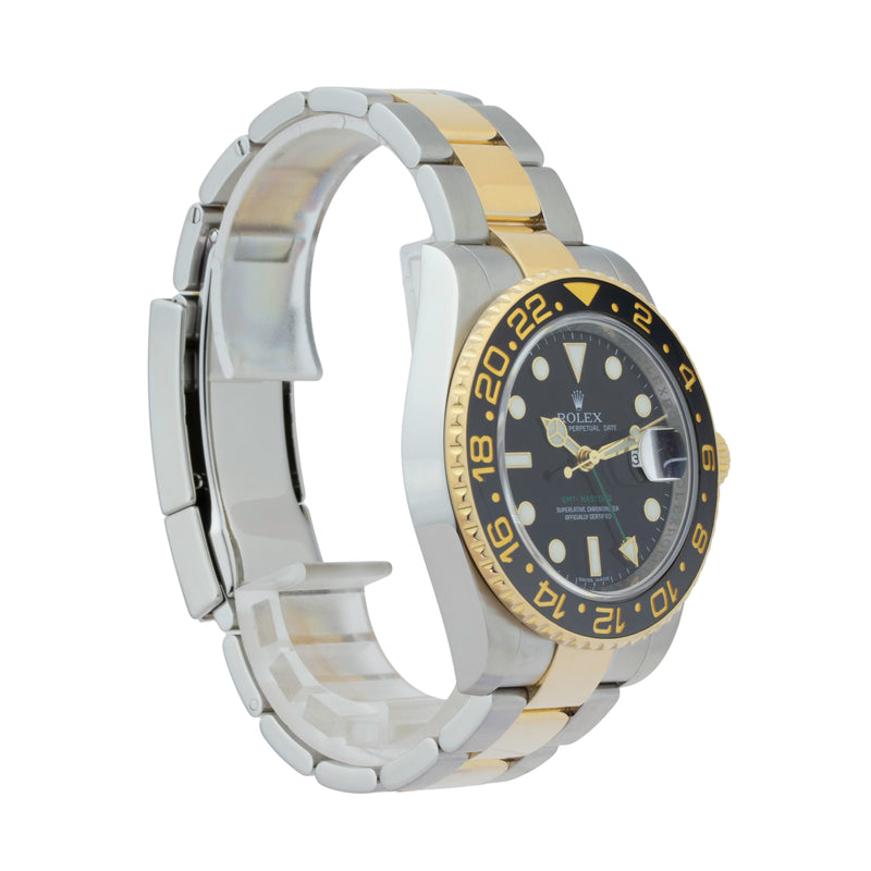 GMT-MASTER II 116713 TWO-TONE . Brand Rolex  Model GMT-Master II Model Number 116713 Gender Mens/Unisex Movement Automatic 3186 Case Size 40mm Wrist Size 7.5 Inches Case Material Stainless Steel Bezel 18kt Yellow Gold w/ Ceramic insert Crystal Sapphire Bracelet Stainless Steel and 18kt Yellow Gold oyster Dial Color Black Condition Very Good Approximate Age 2010 or newer Box comes with SLW Presentation Box Paper No Warranty One Year SLW Warranty Card Notes ENTER Notes