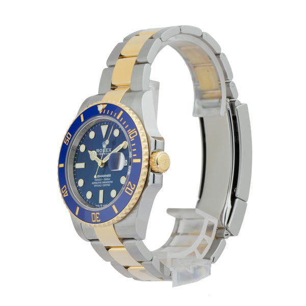 ROLEX SUBMARINER DATE 41 126613LB TWO-TONE . Brand Rolex Model Submariner Model Number 126613LB Gender Mens/Unisex Movement Automatic 3235 Case Size 40mm Wrist Size 7.75 inches Case Material Stainless Steel Bezel 18kt yellow gold w/ceramic insert Crystal Sapphire Bracelet Stainless Steel and 18kt Yellow Gold oyster  Dial  Blue Condition Excellent Approximate Age 2020 Box Yes Paper Yes - 2020 Warranty Comes with one year SLW warranty Notes ENTER Notes