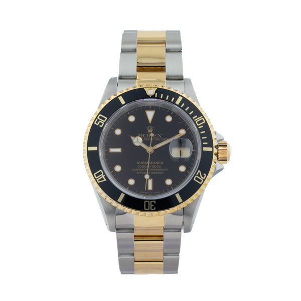 ROLEX SUBMARINER DATE 16613 T TWO-TONE . Brand Rolex Model Submariner Model Number 16613 Gender Men Movement Automatic 3135 Case Size 40mm Wrist Size 8 inches Case Material Stainless Steel Bezel Steel  Crystal Sapphire  Bracelet Stainless Steel and 18kt Yellow Gold Oyster Dial Color Black Condition Very Good Approximate Age 1994 - X serial Box Comes with SLW presentation box Paper Yes - Paper Dated 10/1994 Warranty Comes with one year SLW warranty Notes ENTER Notes