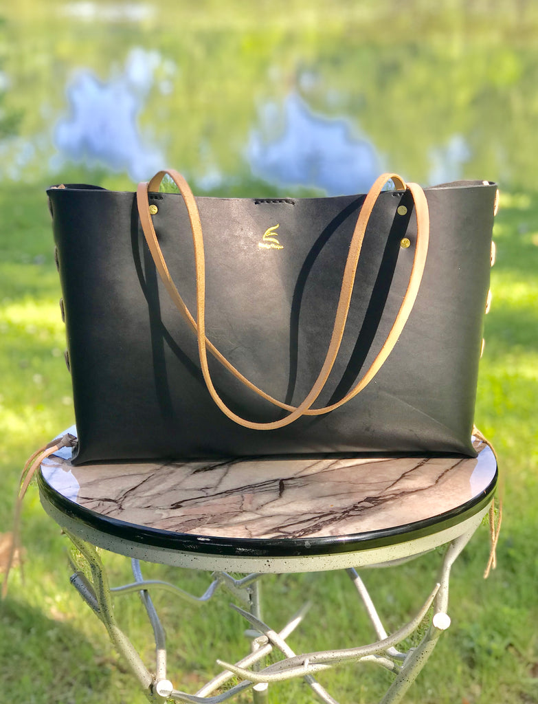 Timeless Tote Bag With A Twist.  Vegetable Tanned Leather tote bag with unique leather lacing.  Etrelya Designs Geo Collection Fall19.