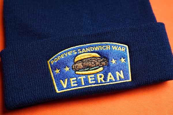 Popeye's Sandwich War Veteran Embroidered Beanie in LSU Louisiana Tigers Colors