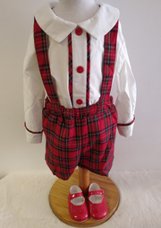 Gorgeous red tartan short dungarees with crossover back. Collared white long sleeved shirt with red button detailing to front and tartan trim to front and cuffs. Popper fastenings to back.