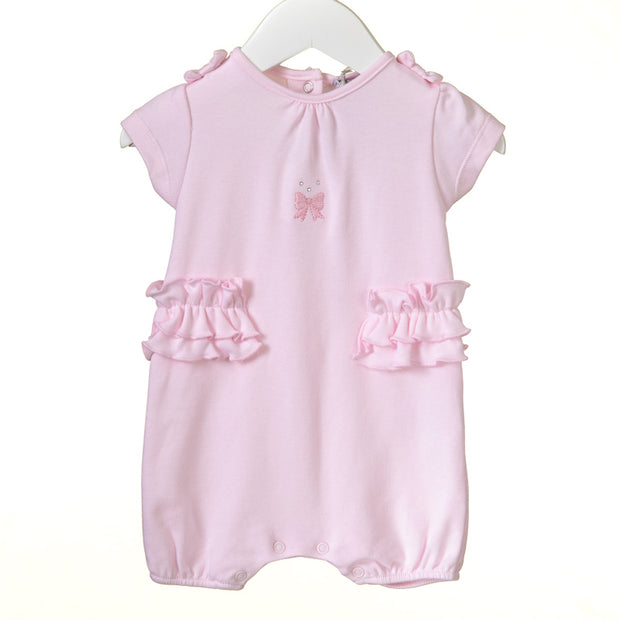 Gorgeous soft 100% cotton pink romper, with diamonte and embroidered bow detail to the front, and a double layer frill to waist. Finished off with bows to shoulders.  Popper fastenings to the back and legs.