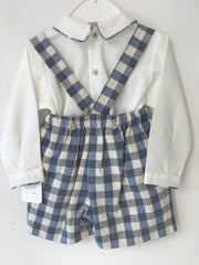 Spanish faux shirt baby grow with button detailing to front and trim to collar. Blue, grey and cream check shirt with braces.   Would look lovely any day of the week or for special occasions!  Why not match with long socks to wear in winter?