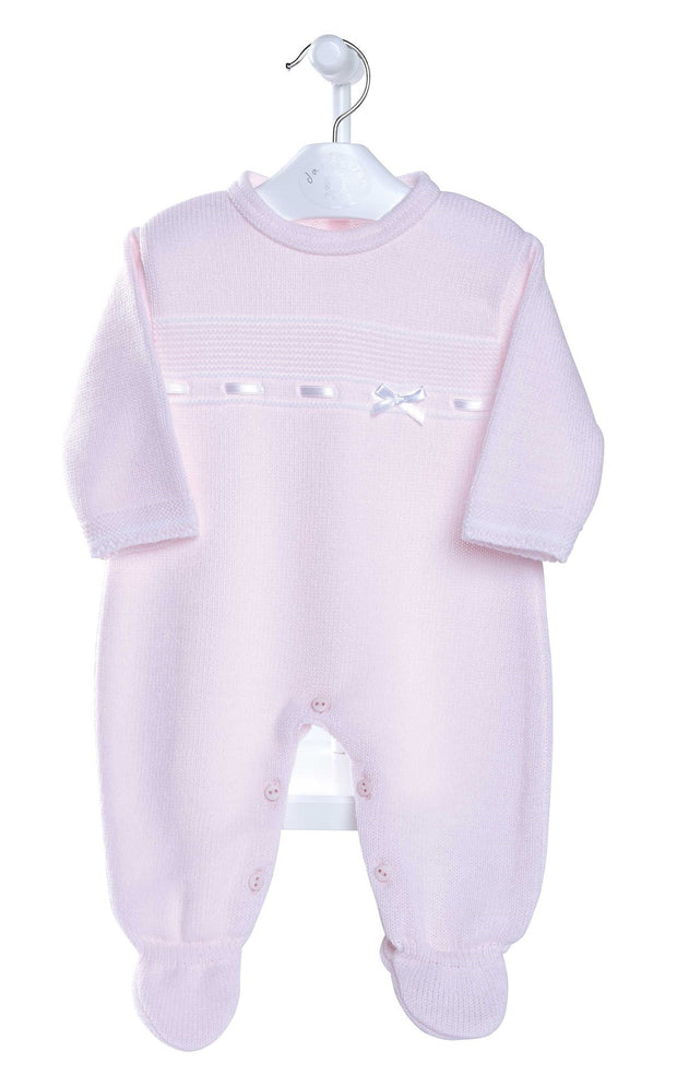 Pink knitted All-in-One with white satin ribbon and bow detail and enclosed feet  to keep little one warm!  Button fastening to neck and legs for easy undressing!