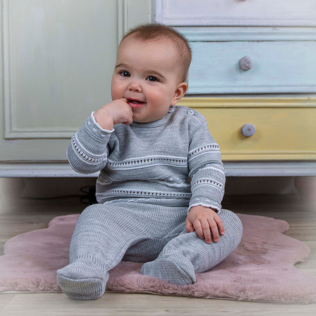 How lovely is this two piece knitted pointelle outfit?  Jumper has button fastenings to shoulder for easy dressing, long legged trousers with feet to keep baby warm during the cooler months.