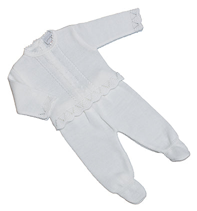 White knitted jumper and trouser suit.   Cable pattern to jumper with frilled hemline, buttons down back. Trousers with feet to keep warm in winter!