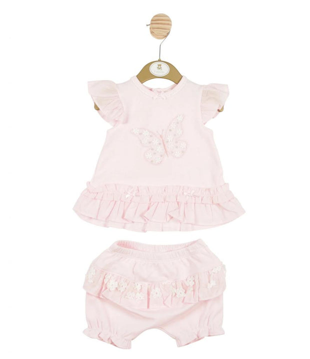Pink frilled top has an embroidered and sequined butterfly to the front. Shorts have a matching lace frill detail and elasticated waist.