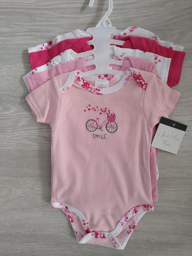 Set of five pink short-sleeved bodysuits, 3 printed and 2 plain. Envelope neck and poppers to legs.
