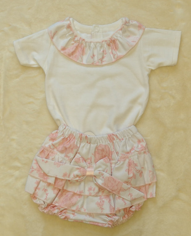 How gorgeous is this?  Silky feel white cotton top with pink and white waffle flower and butterfly print collar. Pink and white waffle print jam pants with large bow.  100% cotton
