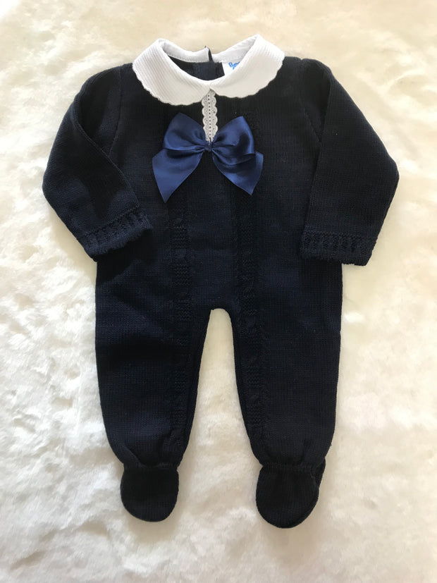 Knitted navy All in One with bow and lace detail and white peter pan collar. Feet to keep warm in cooler weather - perfect for winter or even as a Christmas outfit!
