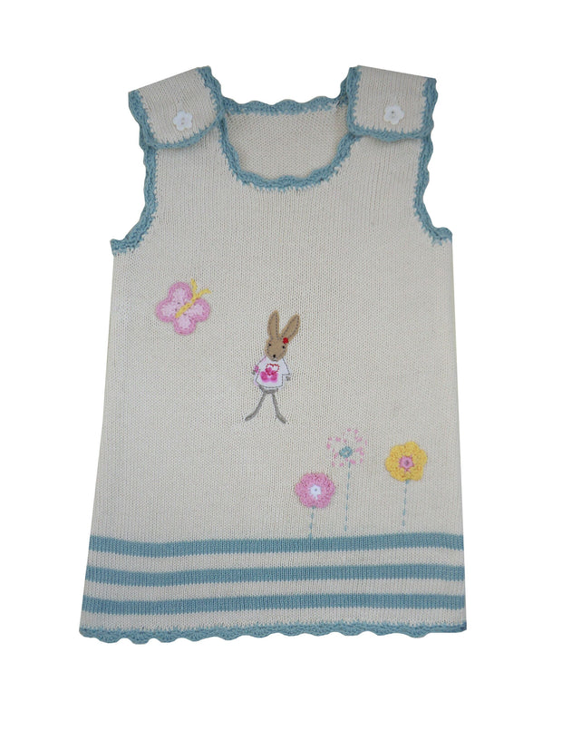 This knitted cotton cream dress has scalloped blue edging to neck and hemline, appliquéd mouse and crochet butterfly and flower motifs. Flower shaped buttons to straps - even comes with spare buttons if needed!  100% cotton, cool wash only so you can enjoy it for even longer.