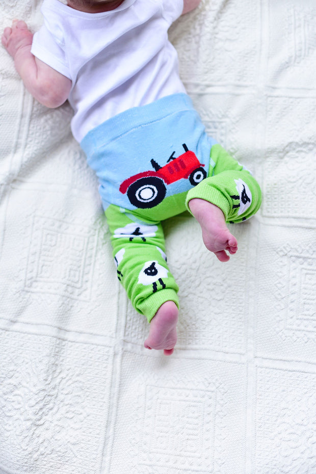 100% cotton knitted leggings with tractor print to back, perfect fit over nappies. And how cute are those sheep!  Great for both girls and boys.   Machine washable. Cotton, nylon, polyester and elastane mix.