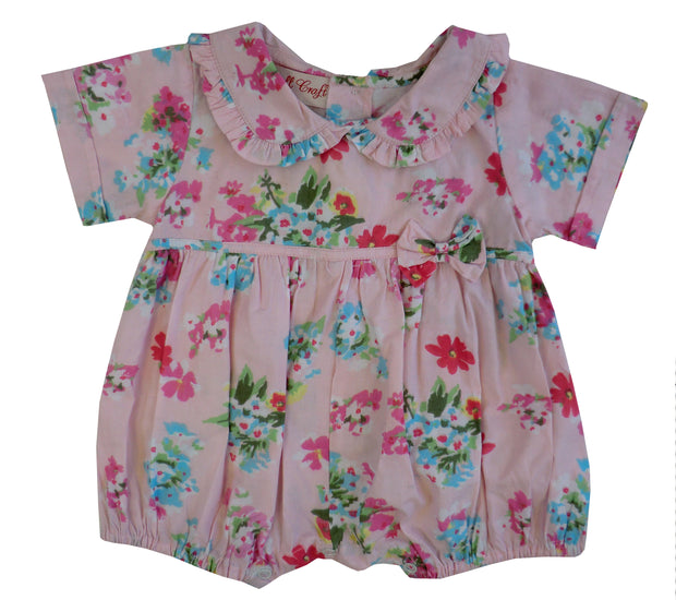 How adorable is this?  Pink flower print romper with with peter pan collar and gathered waistline with bow.