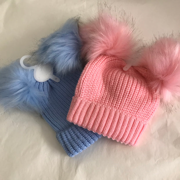 Thick ribbed hats with double faux fur pom poms to keep little ones warm!  Available in pink and blue.