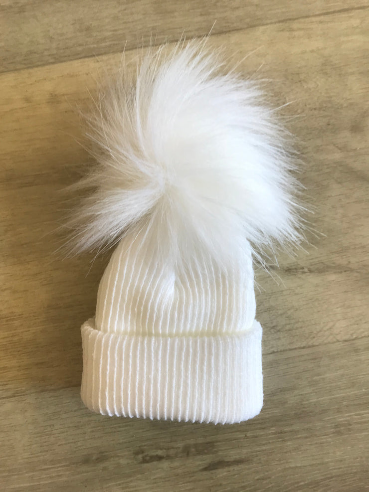 Pull on fine ribbed white hat with single faux fur pom pom - perfect for keeping little one's ears warm this winter!  Also available in blue and pink, and with double pom poms!