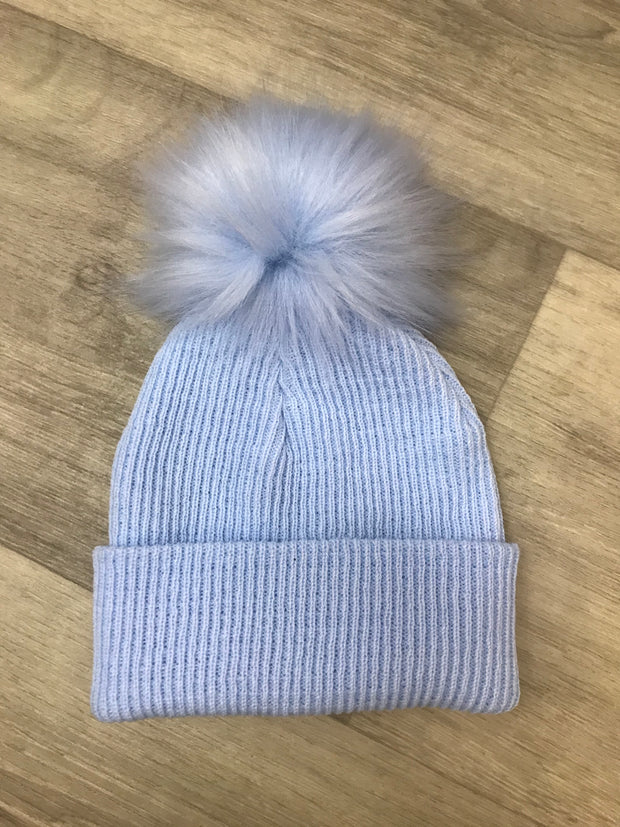 Pull on fine ribbed blue hat with single faux fur pom pom - perfect for keeping little one's ears warm this winter!  Also available in pink and white, and also with double pom poms!