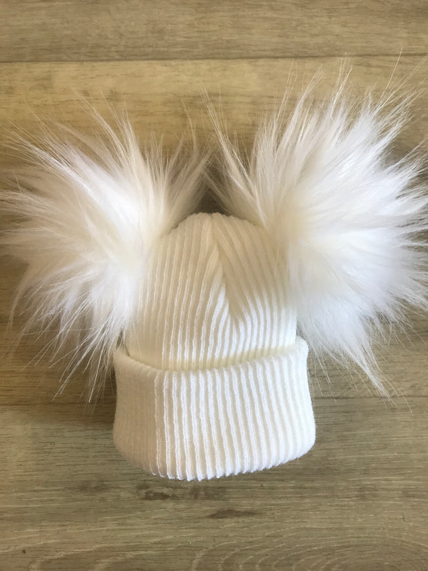 Pull on fine ribbed white hat with double faux fur pom poms - perfect for keeping little one's ears warm this winter!  Also available in blue and pink, and with single pom pom!
