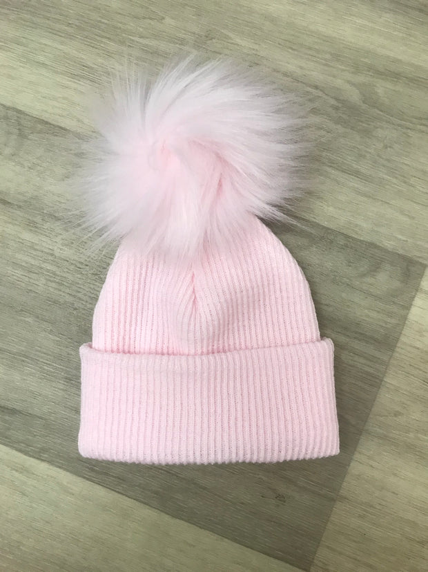Pull on fine ribbed pink hat with single pom pom - perfect for keeping little one's ears warm this winter!  Also available in blue and white, and also with double pom poms!