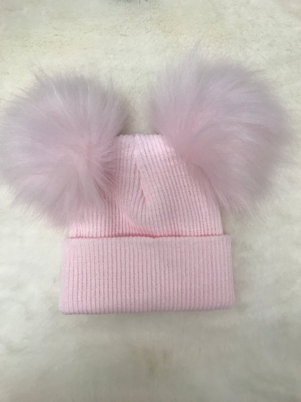 Pull on fine ribbed pink hat with double faux fur pom pom - perfect for keeping little one's ears warm this winter!  Also available in blue and white, and also with single pom pom!