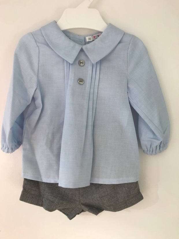 Spanish outfit, blue shirt with collar, pin tuck front and button detail to front. Buttons down back of shirt. Comes with either grey or beige shorts.   Why not wear with long socks in winter?
