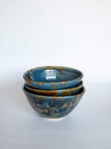 3 stacked wheel-thrown pottery bowls blue green gold