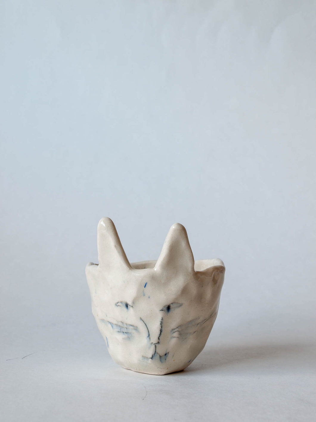 pinched pottery kitty planter with hand-drawn face